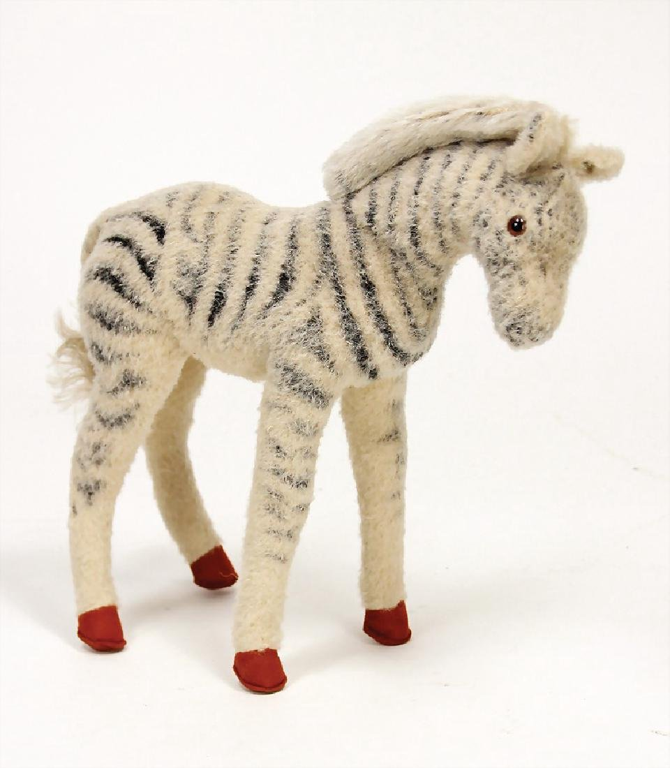 STEIFF zebra, with button, block letters with long