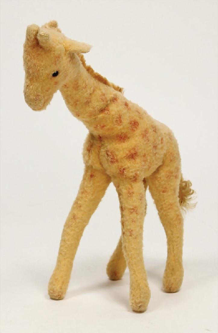 STEIFF giraffe, with button, block letters with long