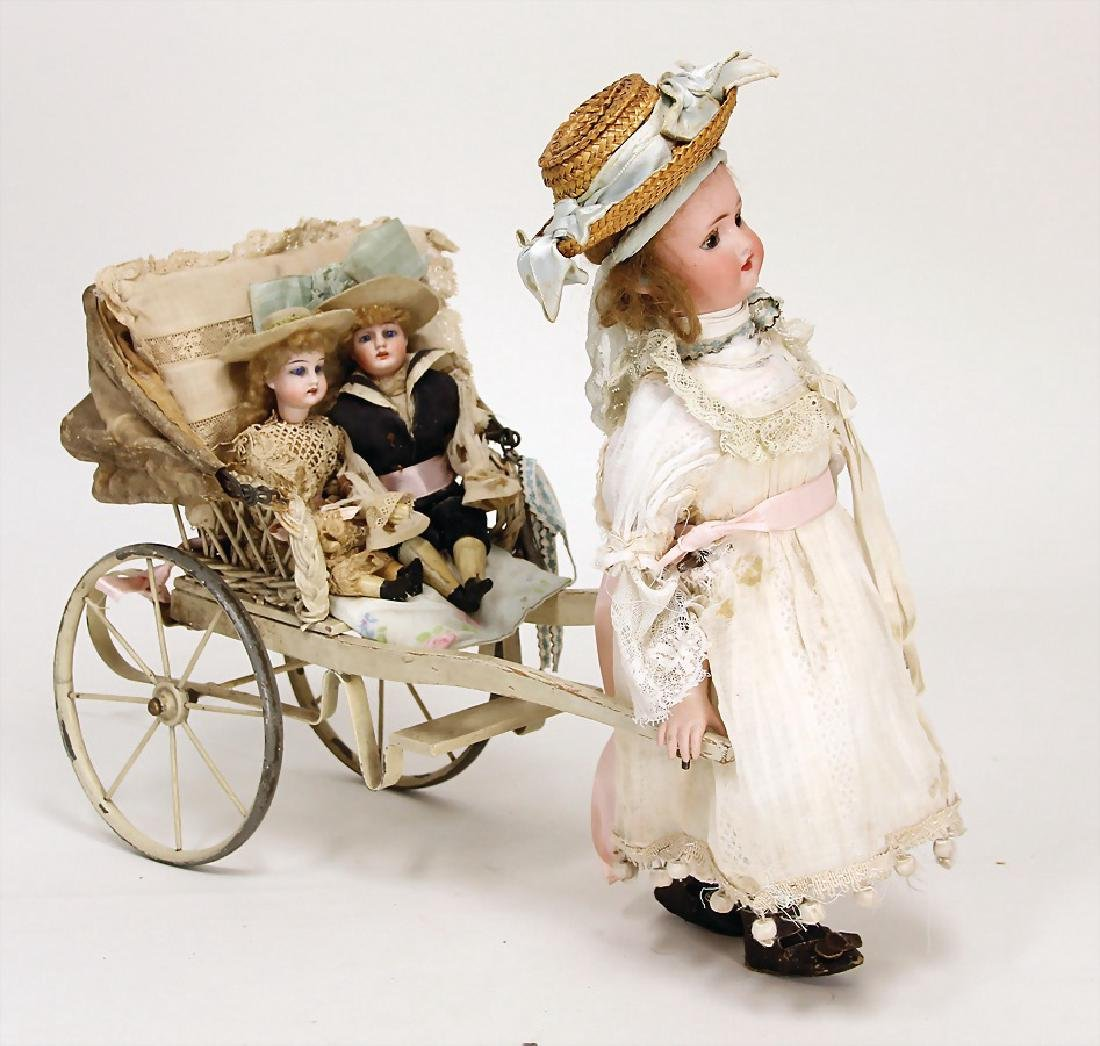 French doll pulling machine, bisque porcelain head, fix