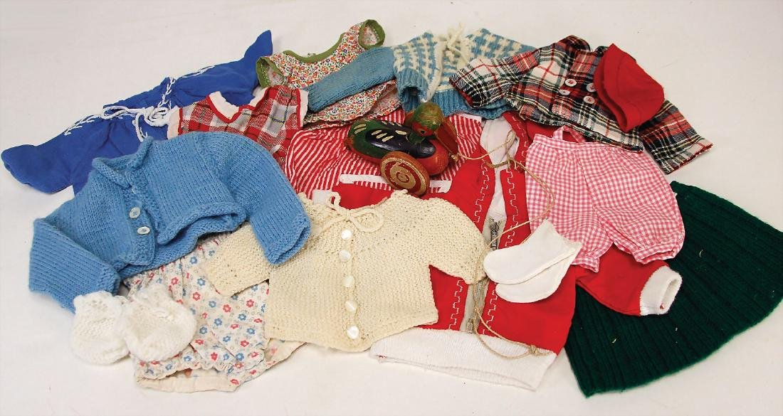 mixed lot of  doll's clothes, different ages, for c. 30