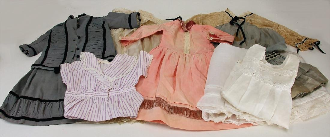 mixed lot of  doll's clothes, different ages, for a c.