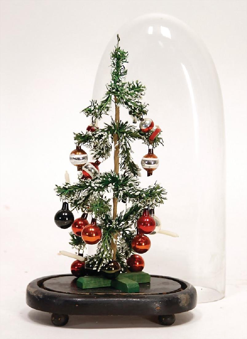 small christmas tree, in a glass case, with mirror
