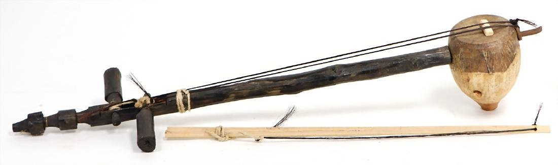 spike tube lute, with 2 horsehair strings, simple bow,
