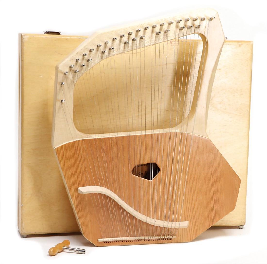 lyre, 35 strings, in a wooden box, signed Leierbau im