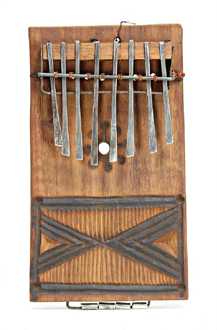 Sansa, from Zambia, board with ornaments, 8 iron tines,