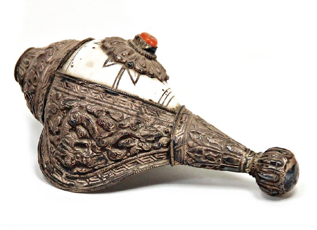 conch shell horn, India, decorated with rolled silver,