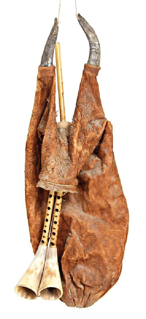 bagpipe, Tunisia, goatskin bag, double pipe each with a