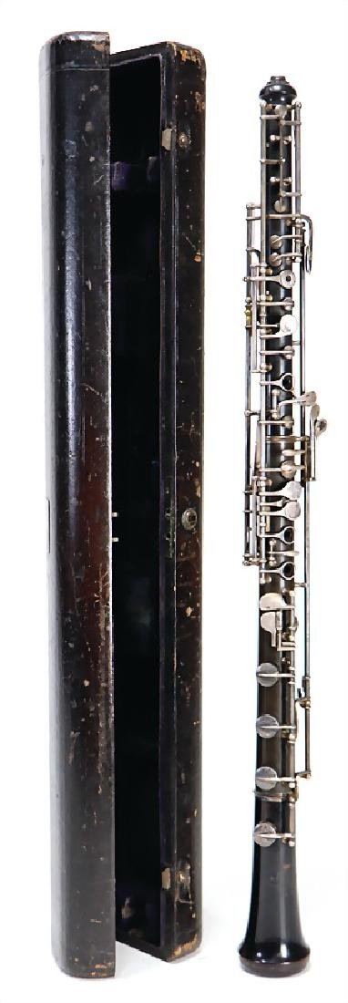 RUDALL & CARTE, LONDON Oboe, made of plastic,