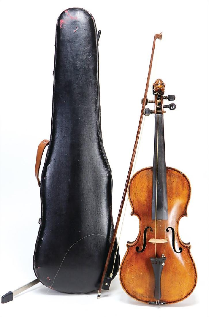 violin, with carved pegbox, in the case, with canvas,
