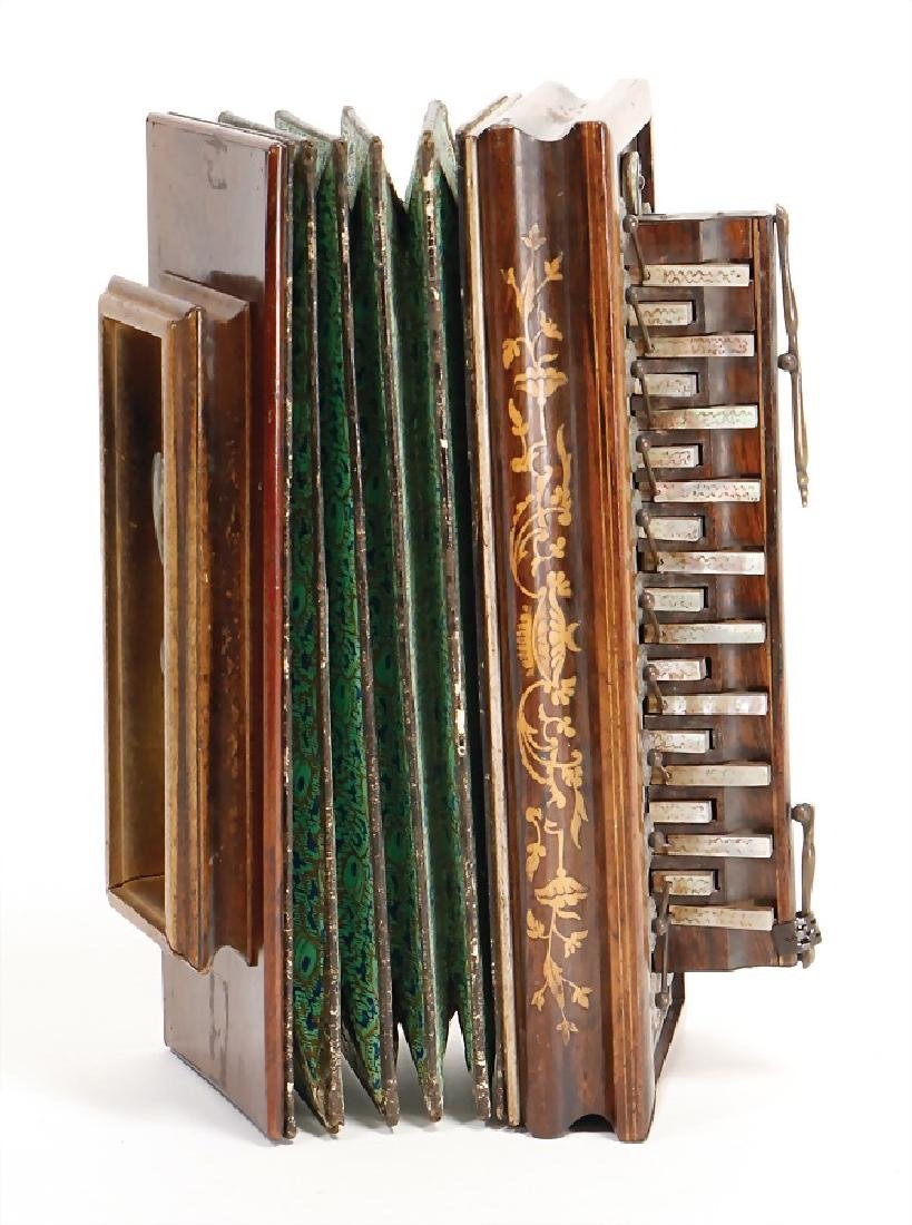 old accordion with inlaid work and  mother-of-pearl