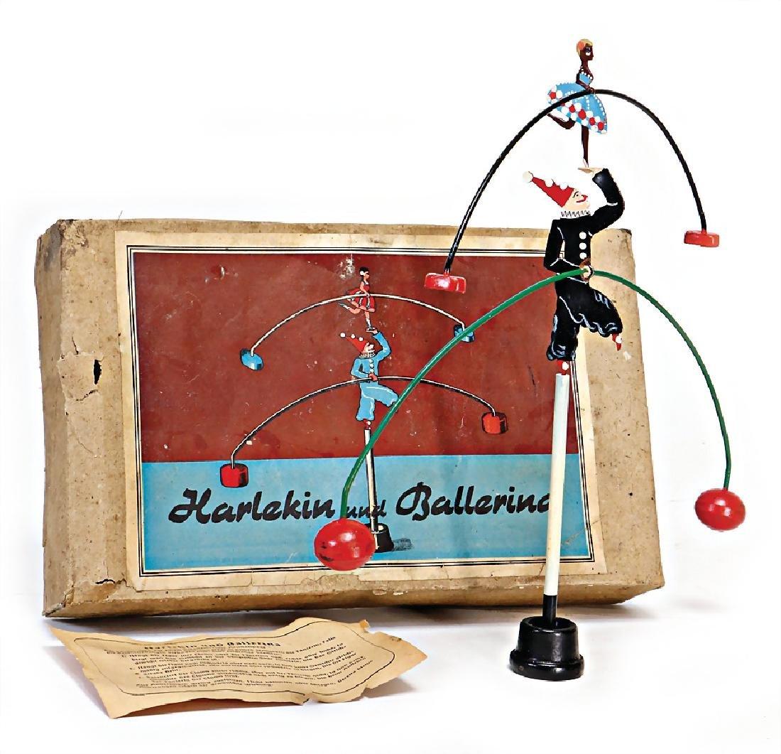 harlequin and  ballerina, the balancing pair of