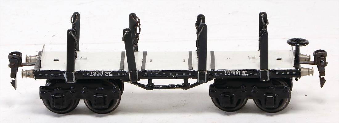 MäRKLIN 4-axled stake wagons, black/white, with 8