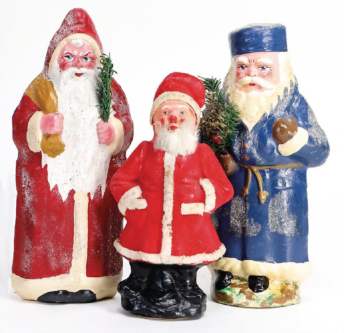 3 pieces made of papier mâché and  mass, Santa Clauses,