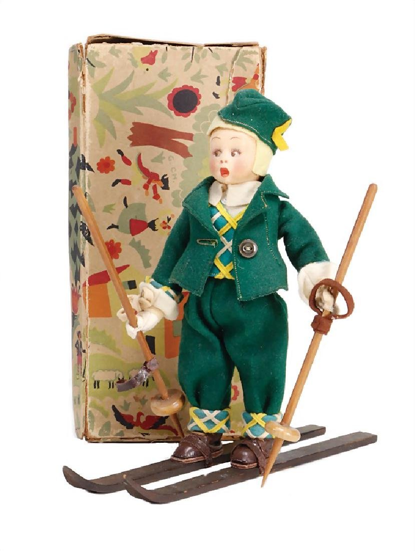 LENCI skier, felt head, in a box, with green felt