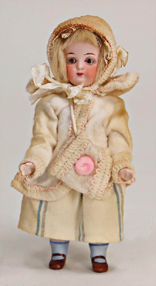 small all-bisque doll, marked 5112, 17 cm, fix head,
