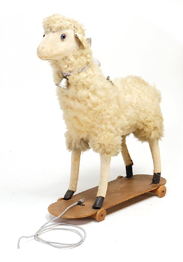 wool sheep with pull voice, 40 cm, on wooden board