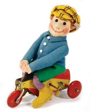 STEIFF Urboy, produced 1926, felt doll on a