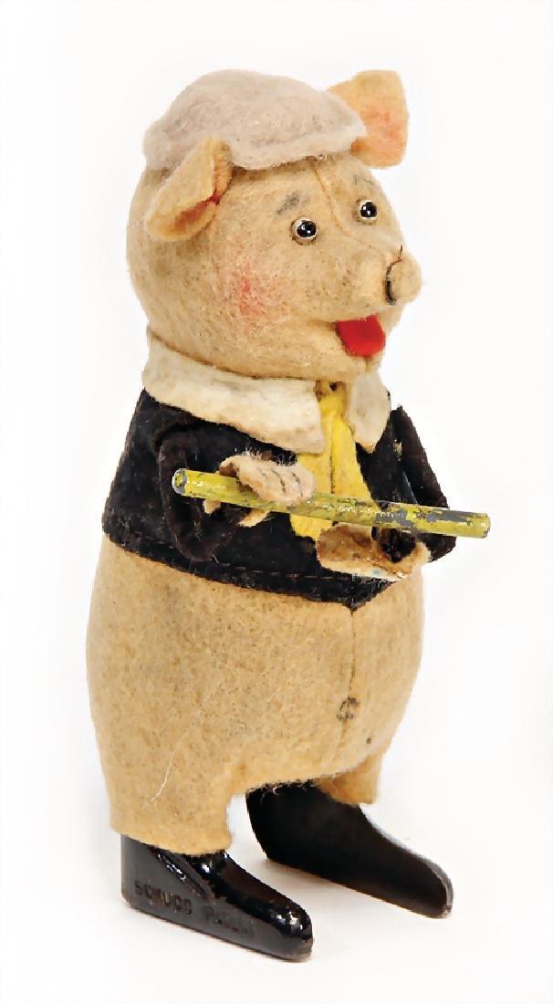 SCHUCO dancer, pig with flute, 11.5 cm, clock mechanism