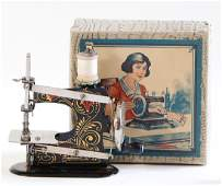 CASIGE sewing machine, No. 0, gold / red decor, in