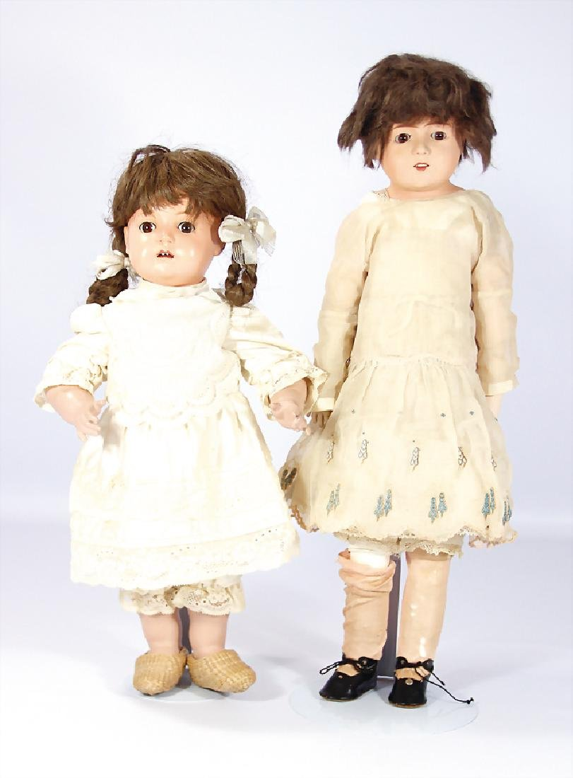 2 Celluloid-Puppen, 1x Celluloid-Brustblatt,