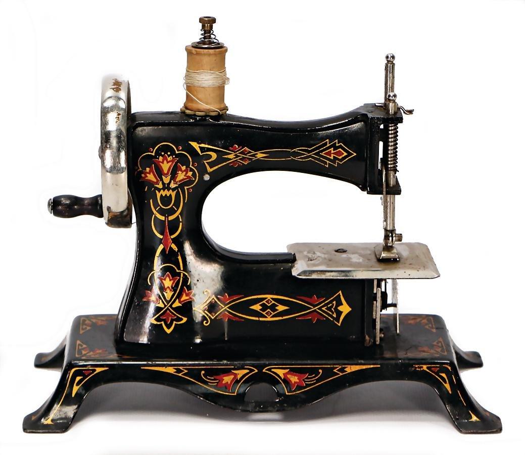 children`s sewing machine, heavy tin construction, 23