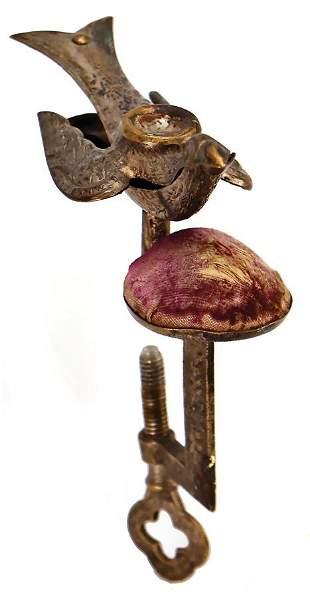 pincushion with needle holder shaped like a bird