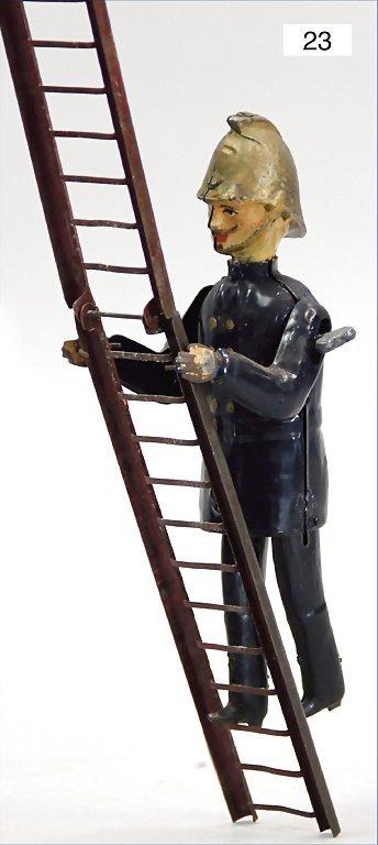 F.N., fireman, climbing a ladder, tin handpainted, was