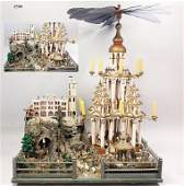 Christmas pyramid with paradise garden and figures, c.
