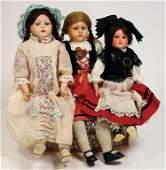 SCHILDKRÖT 3 Celluloid-Brustblattkopf-Puppen, 1x gem.
