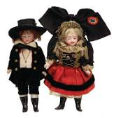 2 pieces all-bisque dolls with traditional costumes,