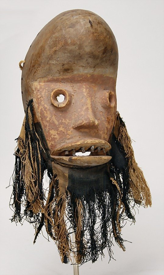 Gere, carved wooden mask with fabric and metal threads,