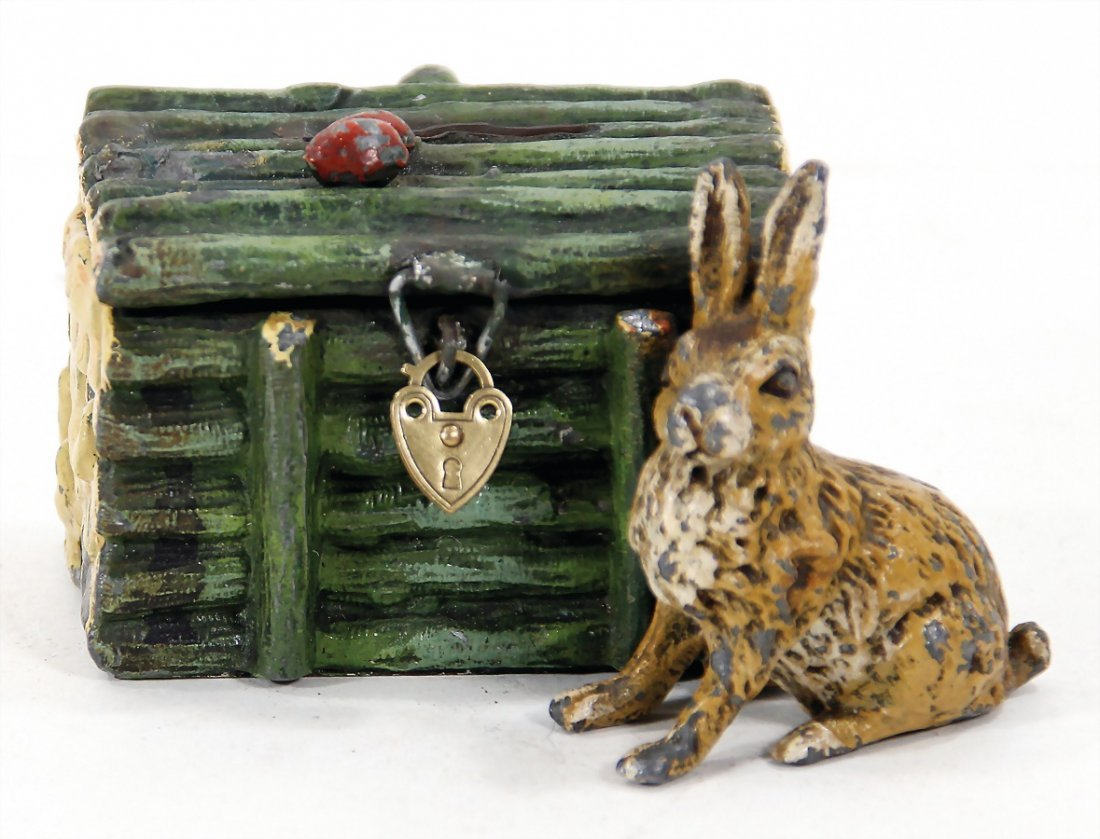 money box, metal/casting, hare with pile of wood,