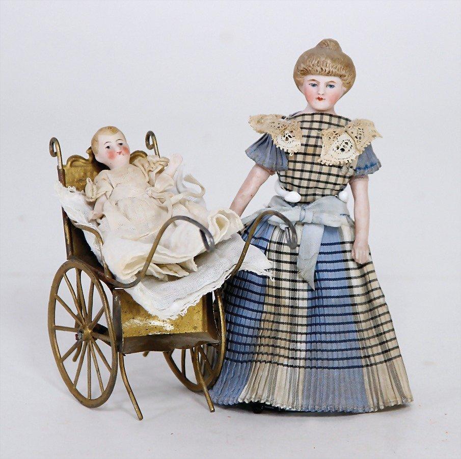 dollhouse pram, sheet metal, tin wheels with spokes,