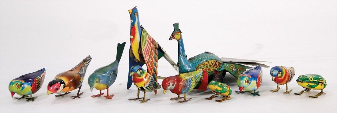 Konv. Blechspielzeug, darunter 7 Vögel, 2 Frö
