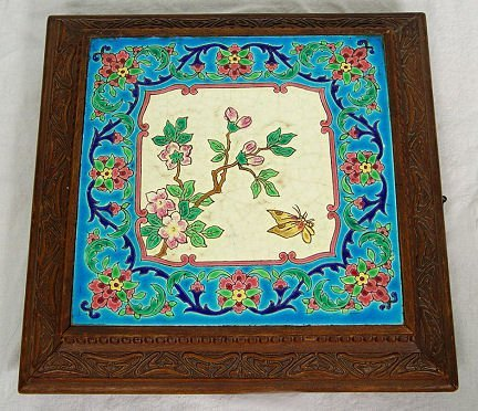 1011: FRENCH LONGWY POTTERY TILE IN A MUSICAL PLATEAU