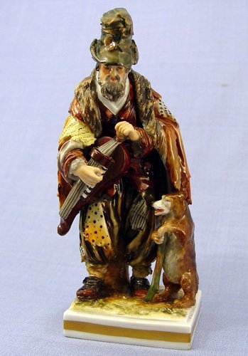 1016: RUSSIAN PORCELAIN FIGURE OF MAN WITH BEAR 19th C
