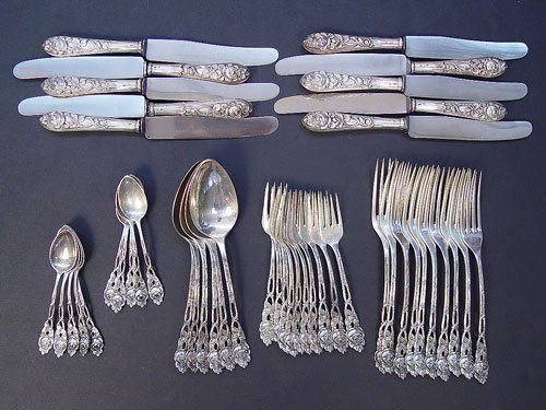 1203: ROSE HANDLE AMD 800 GERMAN SILVER FLATWARE 46 PC