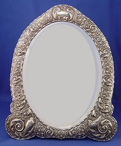 11: ENGLISH REPOUSSE STERLING FRAMED EASEL BACK MIRROR