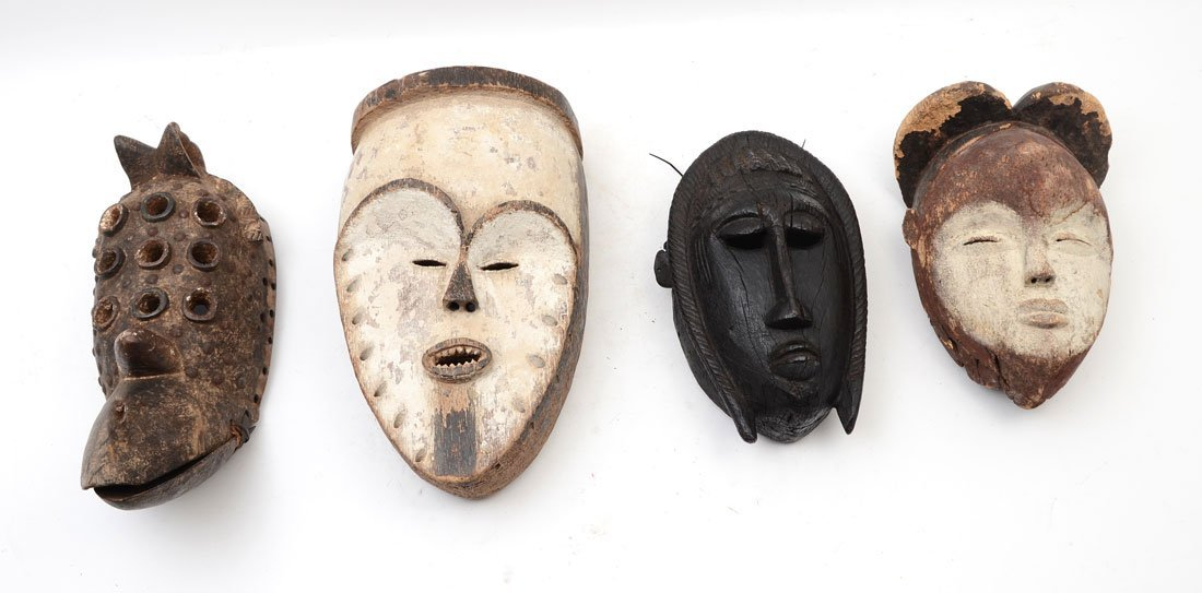 COLLECTION OF 4 CARVED AFRICAN MASKS