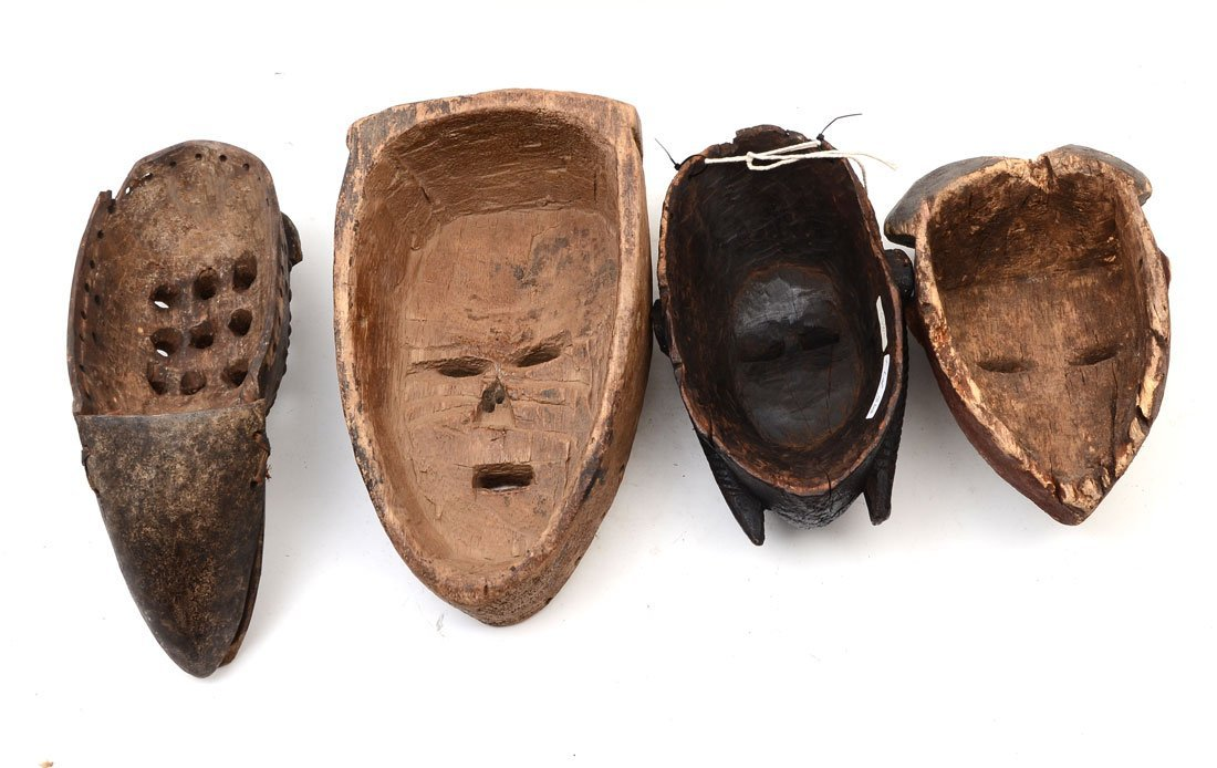 COLLECTION OF 4 CARVED AFRICAN MASKS - 2