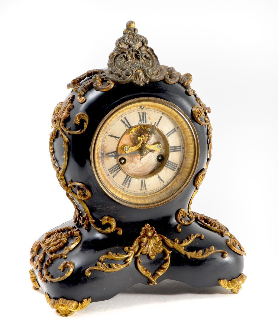 WATERBURY CAST IRON AND GILT METAL MANTLE CLOCK