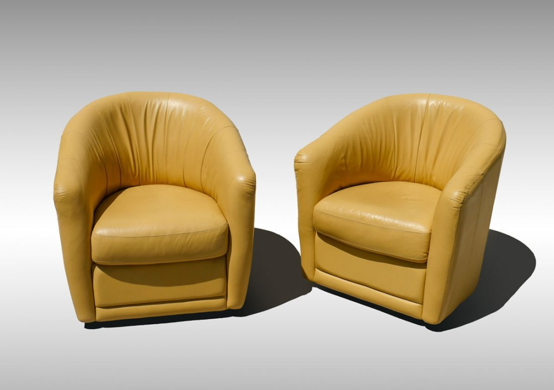 PAIR OF ITALIAN LEATHER BARREL-BACK CHAIRS
