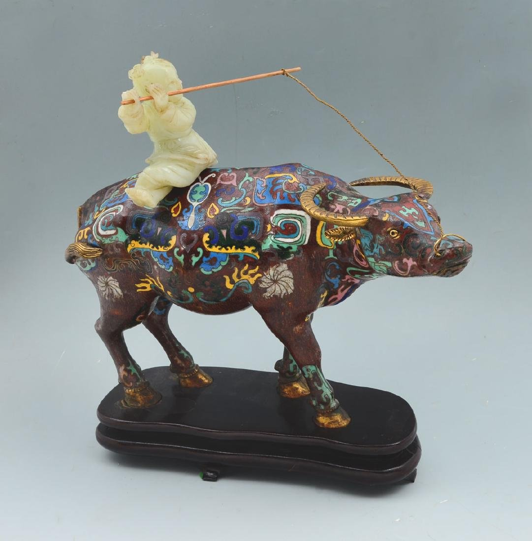 CHINESE QING DTNASTY CLOISONNE OX WITH RIDING JADE