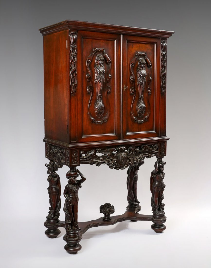 HIGHLY CARVED FIGURAL CUPBOARD