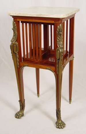 1023: FRENCH REVOLVING MARBLE TOP ORMOLU BOOKCASE