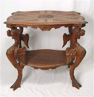 CONTINENTAL GRIFFIN CARVED WALNUT SIDE TABLE