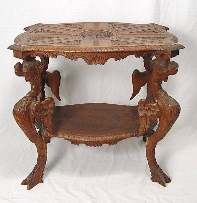 1018: CONTINENTAL GRIFFIN CARVED WALNUT SIDE TABLE