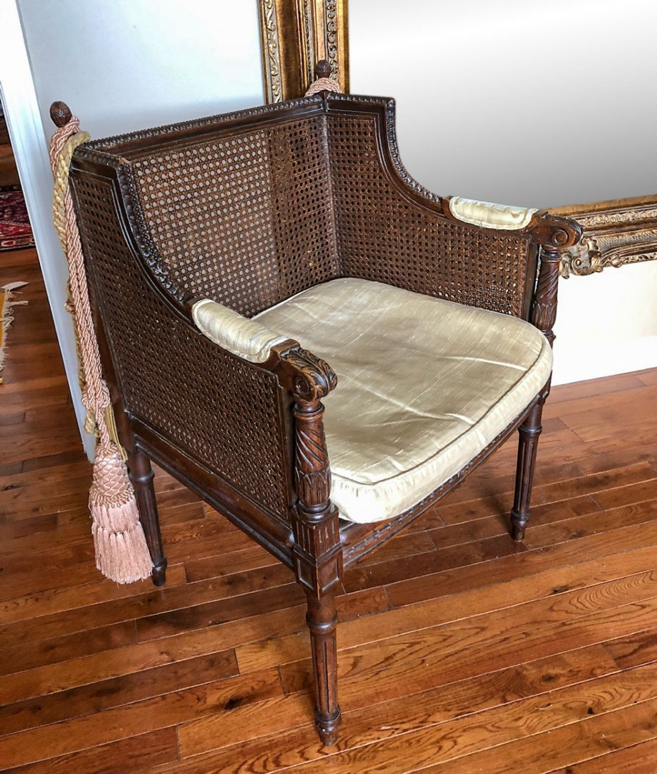 CARVED CANE BACK CHAIR