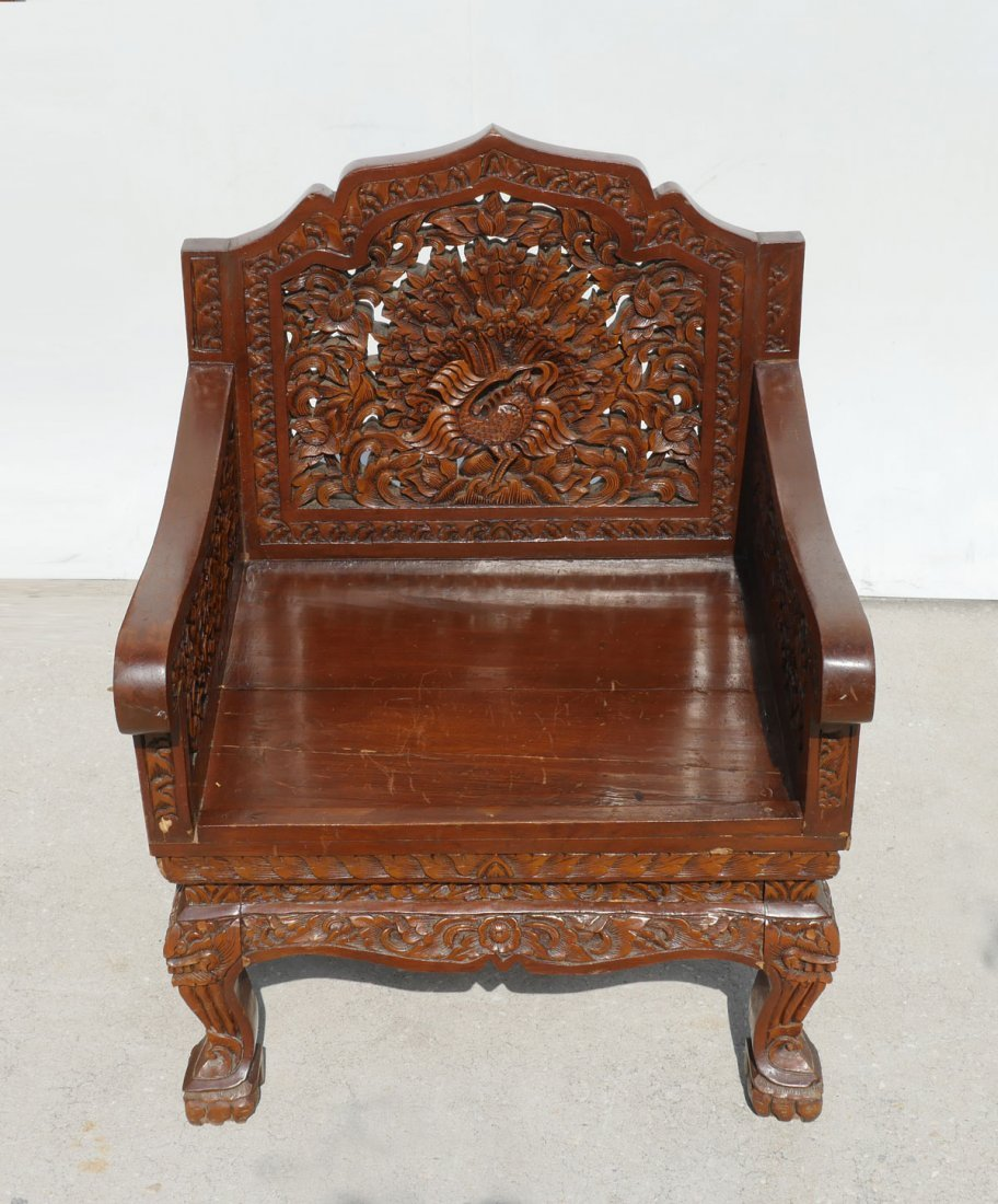 CARVED SOUTH EAST ASIAN ARM CHAIR