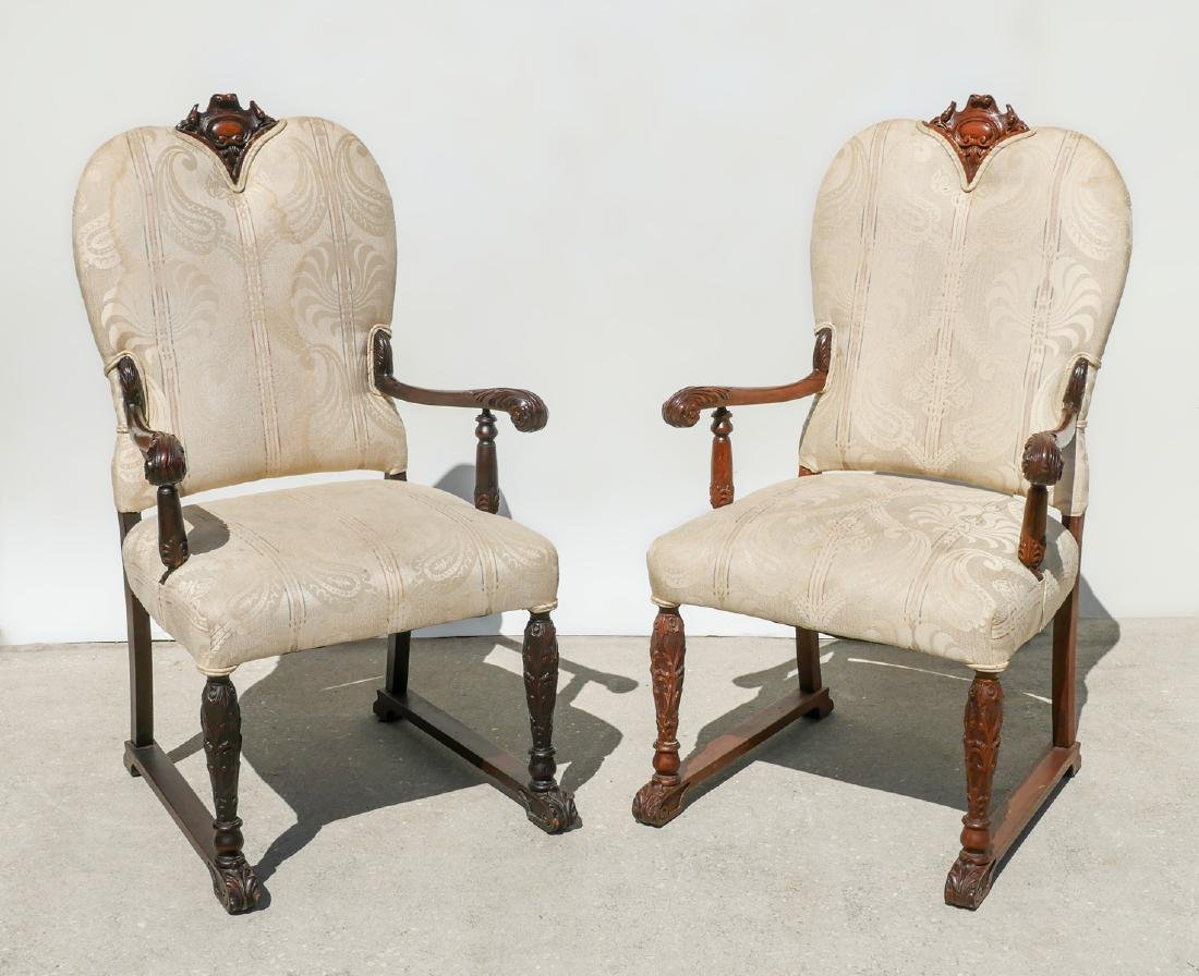 PAIR OF CARVED FOLIATE CHAIRS